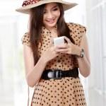 Rero asian woman smiling using cellphone — Stock Photo #51269159