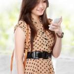 Rero asian woman smiling using cellphone — Stock Photo #51269169