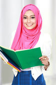 Attractive young student studying — Stock Photo