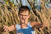 Boy among the reeds — Stock Photo