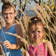 Children among the reeds — Stock Photo #14057514