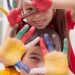 Children with colored hands — Stock Photo #16692813