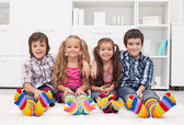 Children with colorful socks — Stock Photo