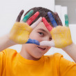 Boy with colored hands — Stock Photo
