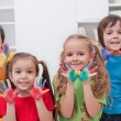 Children with colored hands — Stock Photo #17493931