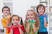 Children with colored hands — Stock Photo