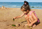 Little girl playing on the seaside — Stock Photo