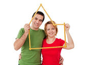 Happy couple with meter — Stockfoto