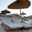 Stock Photo: Sun loungers on beach