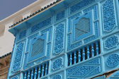 Blue window in the tunisian architecture — Stock Photo