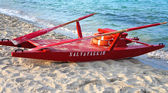 Red rescue boat on the beach — Stock Photo