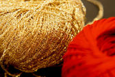 Golden and red yarns — Stock Photo