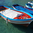 Stock Photo: Wooden fishing boats on crystalline water
