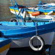 Stock Photo: Colorful fishing boat moored on crystalline sea