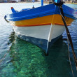 Stock Photo: Yellow Fishing boat on crystalline sea