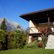 Chalet with mountain on the background — Stock Photo