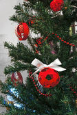 Adorned christmas tree with red and white decorations — Stock Photo