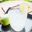 Tasty fresh lime juice with lime on wood table — Stock Photo