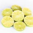 Half portion citrus lime slice on white background — Stok fotoğraf