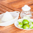 After squashed fresh lime on wood counter — Stock Photo #27159309