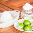 After squashed fresh citrus lime on wood table — Stock Photo #27159451