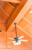 Hanging wood ceiling fan with glass lamps — Stock Photo