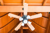 Classical wood ceiling fan with white glass lamps — Stock Photo