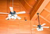 Old style wood ceiling fans with white glass lamps — Stock Photo