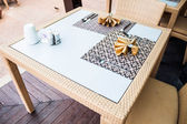 Opened air of oriental style dining table — Stock Photo