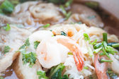 Close up shrimp topped on thai style spicy noodles soup — Stock fotografie