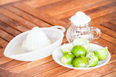 After squashed fresh lime on wood counter — Stock Photo