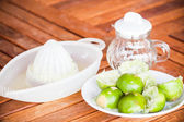 After squashed fresh citrus lime on wood table — Stock Photo