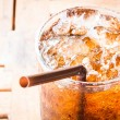 Fresh cola drink with ice on wood table — Stock Photo