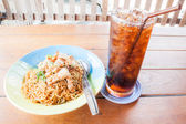 Easy meal with stir fried spicy noodles and cola — Stock Photo