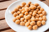 Close up of peanuts coated with spicy seasoning — Stock Photo