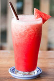 Red water melon fruit juice frappe on wood table — Stock Photo