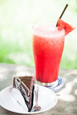 Water melon fruit juice frappe and chocolate cake — Stock Photo