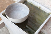 Old style thai used water bowl — Stockfoto