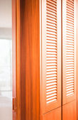 Wooden closet and translucent mirror partition in the room — Stock Photo
