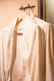 White towels on wooden hanger in dressing room — Stock Photo