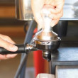 Stockvideo: Barista tamping the grind coffee