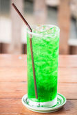 Green drink with out alcohol on wooden table — Stock Photo