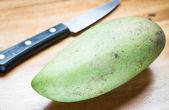 Green mango prepare for peeling — Stock Photo