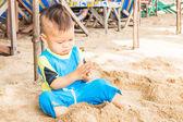 Asian cute boy playing sand on the beach — Zdjęcie stockowe