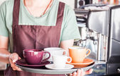 Barista preparing set of freshly brewed coffee for serving — Stock Photo