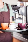 Barista serving set of freshly brewed coffee — Stock Photo
