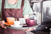 Coffee shop owner serving set of freshly brewed coffee — Stock Photo