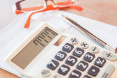 Calculator, pen and on bank account passbook — Stock Photo