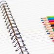 Colorful pencils and notebook — Stock Photo