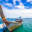 Longtail boat and blue dock — Stock Photo
